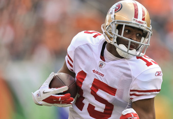 CINCINNATI, OH - SEPTEMBER 25:  Michael Crabtree #15 of the San Francisco 49ers runs with the ball after making a catch against the Cincinnati Bengals at Paul Brown Stadium on September 25, 2011 in Cincinnati, Ohio.  (Photo by Jamie Sabau/Getty Images)