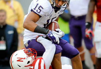 LINCOLN, NE - SEPTEMBER 17: Jermaine Kearse #15 of the Washington Huskies hauls in a touchdown over Andrew Green #11 of the Nebraska Cornhuskers during their game at Memorial Stadium September 17, 2011 in Lincoln, Nebraska. Nebraska won 51-38.(Photo by Er