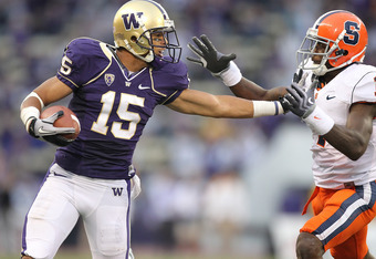 SEATTLE - SEPTEMBER 11:  Wide receiver Jermaine Kearse #15 of the Washington Huskies rushes against Phillip Thomas #1 of the Syracuse Orange on September 11, 2010 at Husky Stadium in Seattle, Washington. The Huskies defeated the Orange 41-20. (Photo by Ot