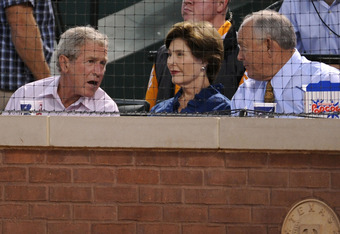 ARLINGTON, TX - OCTOBER 08:  Former President George W. Bush and Laura Bush sit with Texas Rangers CEO & President Nolan Ryan during Game One of the American League Championship Series between the Detroit Tigers and the Rangers at Rangers Ballpark in Arli