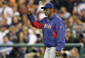 DETROIT, MI - OCTOBER 11:  Manager Ron Washington #38 of the Texas Rangers calls for a pitcher change against the Detroit Tigers in the sixth inning of Game Three of the American League Championship Series at Comerica Park on October 11, 2011 in Detroit,