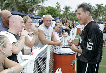 Jim Plunkett with fans at a NFL Kickoff Flag Foot Ball Exhibition at the Tailgate Zone South Beach, Florida on September 6, 2006. (Photo by John Parra/NFLPhotoLibrary)