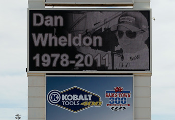 LAS VEGAS, NV - OCTOBER 17:  A tribute to Dan Wheldon, driver of the #77 Dallara Honda, is displayed on a Las Vegas Motor Speedway sign on October 17, 2011 in Las Vegas, Nevada. Dan Wheldon, driver of the #77 Dallara Honda, was killed during the Las Vegas