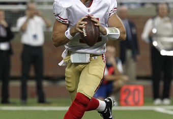 DETROIT, MI - OCTOBER 16:  Alex Smith #11 of the San Francisco 49ers drops back for a pass during a NFL game against the Detroit Lions at Ford Field on October 16, 2011 in Detroit, Michigan.  The 49ers won 25-19 (Photo by Dave Reginek/Getty Images)