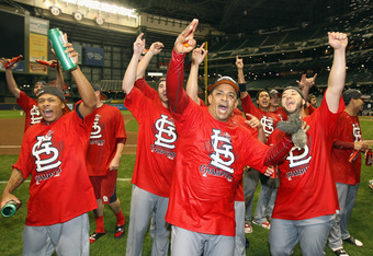 MILWAUKEE, WI - OCTOBER 16:  Octavio Dotel (C) #28 of the St. Louis Cardinals celebrates with his teammates after they won 12-6 against the Milwaukee Brewers during Game Six of the National League Championship Series at Miller Park on October 16, 2011 in