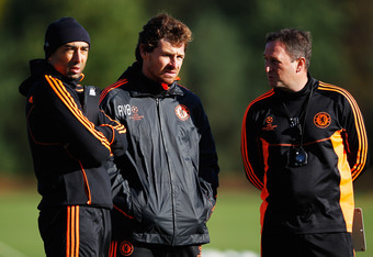 COBHAM, ENGLAND - OCTOBER 18:  Chelsea manager Andre Villas Boas (C) talks to assistant coach Roberto Di Matteo (L) and Steve Holland during a Chelsea training session ahead of the UEFA Champions League Group E match against Genk at Chelsea Training Groun