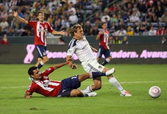 Galaxy striker Adam Cristman breaks free from former Galaxy player Ante Jazic