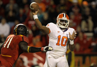 COLLEGE PARK, MD - OCTOBER 15:  Quarterback Tajh Boyd #10 of the Clemson Tigers throws a pass while being pressured by defensive lineman David Mackall #11 of the Maryland Terrapins during the second half at Byrd Stadium on October 15, 2011 in College Park
