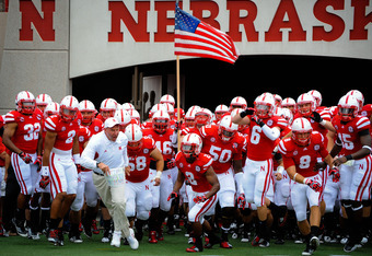 LINCOLN, NE - SEPTEMBER 3: Head Coach Bo Pelini leads his Nebraska Cornhuskers onto the field against the Chattanooga Mocs before their game at Memorial Stadium September 3, 2011 in Lincoln, Nebraska. Nebraska won 40-7. (Photo by Eric Francis/Getty Images