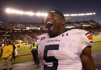 COLUMBIA, SC - OCTOBER 01:  Michael Dyer #5 of the Auburn Tigers celebrates after defeating the South Carolina Gamecocks 16-13 at Williams-Brice Stadium on October 1, 2011 in Columbia, South Carolina.  (Photo by Streeter Lecka/Getty Images)