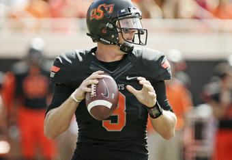 STILLWATER, OK - OCTOBER 8:  Quarterback Brandon Weeden #3 of Oklahoma State looks to throw in the first half against Kansas on October 8, 2011 at Boone Pickens Stadium in Stillwater, Oklahoma.  Oklahoma State defeated Kansas 70-28.  (Photo by Brett Deeri