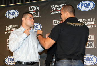 HOLLYWOOD, CA - SEPTEMBER 20:  (L-R) UFC Fighters Cain Velasquez and Junior dos Santos square off for the cameras during the UFC on Fox: Velasquez v Dos Santos - Press Conference at W Hollywood on September 20, 2011 in Hollywood, California.  (Photo by Vi