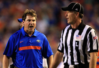 GAINESVILLE, FL - OCTOBER 01:  Head coach Will Muschamp of the Florida Gators speaks to an official during a game against the Alabama Crimson Tide at Ben Hill Griffin Stadium on October 1, 2011 in Gainesville, Florida.  (Photo by Sam Greenwood/Getty Image