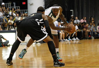 MIAMI, FL - OCTOBER 08: LeBron James (R) posts up Carmelo Anthony during the South Florida All Star Classic at Florida International University on October 8, 2011 in Miami, Florida.  (Photo by Mike Ehrmann/Getty Images)