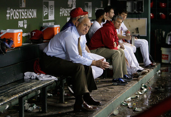 ARLINGTON, TX - OCTOBER 08:  CEO & President Nolan Ryan looks on from the dugout during a rain delay in the fifth inning of Game One of the American League Championship Series between the Detroit Tigers and the Texas Rangers at Rangers Ballpark in Arlingt