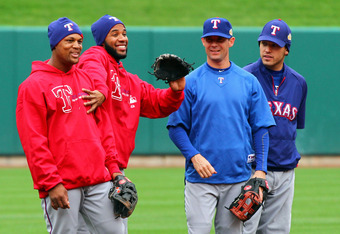 ST LOUIS, MO - OCTOBER 18:  (L-R) Adrian Beltre #29, Elvis Andrus #1, Michael Young #10 and Ian Kinsler #5 stand in the field during batting practice and at Busch Stadium on October 18, 2011 in St Louis, Missouri. The Texas Rangers will take on the St. Lo