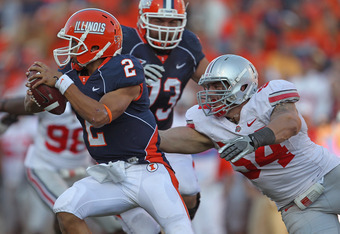 CHAMPAIGN, IL - OCTOBER 15:  Nathan Scheelhaase #2 of the Illinois Fighting Illini tries to escape from John Simon #54 of the Ohio State Buckeyes at Memorial Stadium on October 15, 2011 in Champaign, Illinois. Ohio State defeated Illinois 17-7.  (Photo by