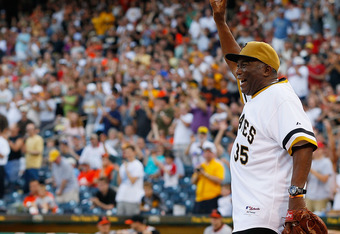 PITTSBURGH - JUNE 21:  Manny Sanguillen #35 of the World Series Champion 1971 Pittsburgh Pirates salutes the crowd after catching the first pitch from former Pittsburgh Pirates pitcher Steve Blass #28 before the game against the Baltimore Orioles on June
