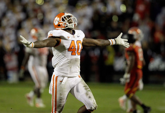 COLLEGE PARK, MD - OCTOBER 15: Defensive end Andre Branch #40 of the Clemson Tigers celebrates during the closing moments of the Tigers' 56-45 win over the Maryland Terrapins at Byrd Stadium on October 15, 2011 in College Park, Maryland.  (Photo by Rob Ca