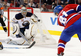 MONTREAL, CANADA - OCTOBER 18:  Ryan Miller #30 of the Buffalo Sabres stops the puck on a shot by Lars Eller #81 of the Montreal Canadiens during the NHL game at the Bell Centre on October 18, 2011 in Montreal, Quebec, Canada.  (Photo by Richard Wolowicz/