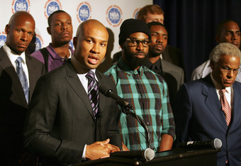 NEW YORK, NY - SEPTEMBER 30:  Derek Fisher (C), President of the National Basketball Players Association is surrounded by players and Billy Hunter NBPA Executive Director (R) as he speaks at a press conference after NBA labor negotiations at The Waldorf-A