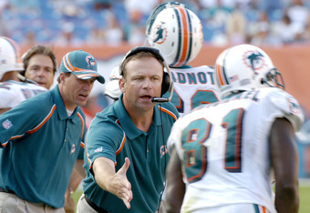 Miami Dolphins offensive coordinator Scott  Linehan applauds  a touchdown against the Buffalo Bills December 4, 2005. The Dolphins defeated the Bills 24-23 on a touchdown with six seconds left in the  game.  (Photo by Al Messerschmidt/Getty Images)