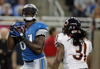 DETROIT, MI - OCTOBER 10:  Calvin Johnson #81 of the of the Detroit Lions hauls in a touchdown pass against Brandon Meriweather #31 of the of the Chicago Bears at Ford Field on October 10, 2011 in Detroit, Michigan.  (Photo by Gregory Shamus/Getty Images)