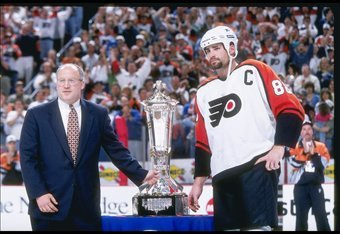 25 May 1997:  Center Eric Lindros of the Philadelphia Flyers gets awarded the Prince of Wales Trophy by Bill Daly after a playoff game against the New York Rangers at the CoreStates Center in Philadelphia, Pennsylvania.  The Flyers won the game, 4-2. Mand