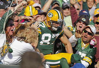 GREEN BAY, WI - OCTOBER 2: Jordy Nelson #87 of the Green Bay Packers does a Lambeau Leap after scoring a touchdown against the Denver Broncos at Lambeau Field on October 2, 2011 in Green Bay, Wisconsin. (Photo by Matt Ludtke /Getty Images)