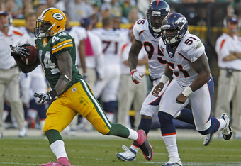 GREEN BAY, WI - OCTOBER 2:James Starks #44 of the Green Bay Packers runs past Joe Mays #51 and Derrick Harvey #95 of the Denver Broncos at Lambeau Field on October 2, 2011 in Green Bay, Wisconsin.  (Photo by Matt Ludtke /Getty Images)