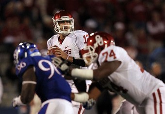 LAWRENCE, KS - OCTOBER 15:  Quarterback Landry Jones #12 of the Oklahoma Sooners passes during the game against the Kansas Jayhawks on October 15, 2011 at Memorial Stadium in Lawrence, Kansas.  (Photo by Jamie Squire/Getty Images)