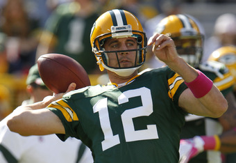 GGREEN BAY, WI - OCTOBER 2: Aaron Rodgers #12 of the Green Bay Packers warms up prior to a game against the Denver Broncos at Lambeau Field on October 2, 2011 in Green Bay, Wisconsin. (Photo by Matt Ludtke /Getty Images)