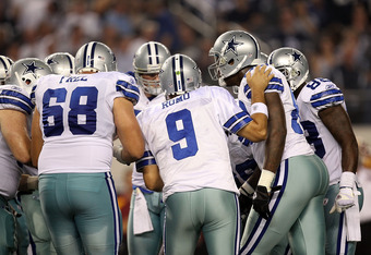 ARLINGTON, TX - SEPTEMBER 26:  Tony Romo #9 of the Dallas Cowboys at Cowboys Stadium on September 26, 2011 in Arlington, Texas.  (Photo by Ronald Martinez/Getty Images)