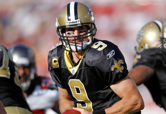 TAMPA, FL - OCTOBER 16:  Quarterback Drew Brees #9 of the New Orleans Saints hands the ball off against the Tampa Bay Buccaneers during the game at Raymond James Stadium on October 16, 2011 in Tampa, Florida.  (Photo by J. Meric/Getty Images)