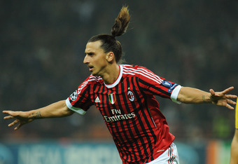 MILAN, ITALY - OCTOBER 19:  Zlatan Ibrahimovic of AC Milan celebrates a goal during the UEFA Champions League group H match between AC Milan and FC BATE Borisov at Giuseppe Meazza Stadium on October 19, 2011 in Milan, Italy.  (Photo by Valerio Pennicino/G
