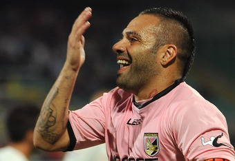 PALERMO, ITALY - SEPTEMBER 21:  Fabrizio Miccoli of Palermo celebrates after scoring his team's third goal during the Serie A match between US Citta di Palermo and Cagliari Calcio at Stadio Renzo Barbera on September 21, 2011 in Palermo, Italy.  (Photo by