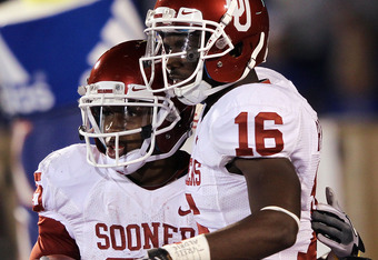 LAWRENCE, KS - OCTOBER 15:  Ryan Broyles #85 of the Oklahoma Sooners is congratulated by Jaz Reynolds #16 after making a touchdown catch during the game against the Kansas Jayhawks on October 15, 2011 at Memorial Stadium in Lawrence, Kansas.  (Photo by Ja