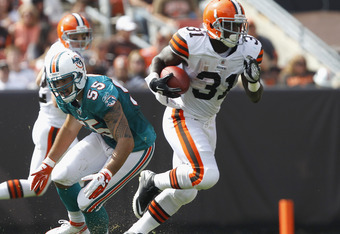 CLEVELAND, OH - SEPTEMBER 25:  Running back Montario Hardesty #31 of the Cleveland Browns runs by linebacker Koa Misi #55 of the Miami Dolphins at Cleveland Browns Stadium on September 25, 2011 in Cleveland, Ohio.  (Photo by Matt Sullivan/Getty Images)