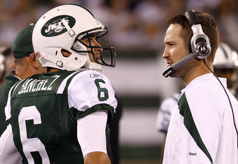 EAST RUTHERFORD, NJ - OCTOBER 17:   Mark Sanchez #6 of the New York Jets talks with offensive coordinator Brian Schottenheimer during their game against the Miami Dolphins at MetLife Stadium on October 17, 2011 in East Rutherford, New Jersey.  (Photo by J
