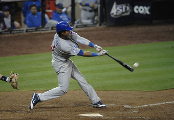 SAN DIEGO, CA - SEPTEMBER 28:  Starlin Castro #13 of the Chicago Cubs hits a double during the eighth inning of a baseball game against the San Diego Padres at Petco Park on September 28, 2011 in San Diego, California.  (Photo by Denis Poroy/Getty Images)