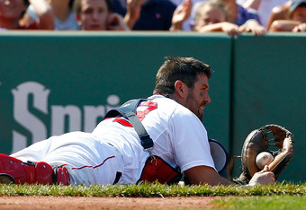 BOSTON, MA  - JULY 28:  Jason Varitek #33 of the Boston Red Sox comes up short on a pop foul ball against the Kansas City Royals at Fenway Park on July 28, 2011 in Boston, Massachusetts.  (Photo by Jim Rogash/Getty Images)