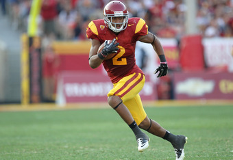 LOS ANGELES, CA - SEPTEMBER 17:  Wide receiver Robert Woods #2 of the USC Trojans carries the ball against the Syracuse Orangemen at the Los Angeles Memorial Coliseum on September 17, 2011 in Los Angeles, California. USC won  38-17.  (Photo by Stephen Dun