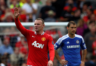 MANCHESTER, ENGLAND - SEPTEMBER 18:  Wayne Rooney of Manchester United celebrates scoring his team's third goal during the Barclays Premier League match between Manchester United and Chelsea at Old Trafford on September 18, 2011 in Manchester, England. (P