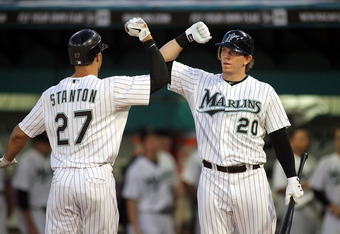 MIAMI GARDENS, FL - SEPTEMBER 19:  Mike Stanton #27 of the Florida Marlins celebrates a solo home run with teammate Logan Morrison #20 against the Atlanta Braves  at Sun Life Stadium on September 19, 2011 in Miami Gardens, Florida.  (Photo by Marc Serota/