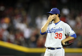 PHOENIX, AZ - SEPTEMBER 28:  Relief pitcher Ramon Troncoso #38 of the Los Angeles Dodgers reacts on the mound during the ninth inning of the Major League Baseball game against the Arizona Diamondbacks at Chase Field on September 28, 2011 in Phoenix, Arizo