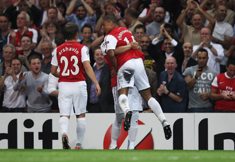 LONDON, ENGLAND - SEPTEMBER 28:  Alex Oxlade-Chamberlain of Arsenal (15) celebrates with Andre Santos and Andrey Arshavin as he scores their first goal during the UEFA Champions League Group F match between Arsenal and Olympiacos at the Emirates Stadium o