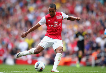 LONDON, ENGLAND - SEPTEMBER 24:  Theo Walcott of Arsenal in action during the Barclays Premier League match between Arsenal and Bolton Wanderers at Emirates Stadium on September 24, 2011 in London, England.  (Photo by Clive Mason/Getty Images)