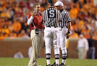 KNOXVILLE, TN - OCTOBER 23:  Nick Saban the Head Coach of the Alabama Crimson Tide talks with the game officals during the SEC game against the Tennessee Volunteers at Neyland Stadium on October 23, 2010 in Knoxville, Tennessee.  (Photo by Andy Lyons/Gett
