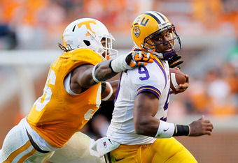 KNOXVILLE, TN - OCTOBER 15:  Jordan Jefferson #9 of the LSU Tigers rushes away from Curt Maggitt #56 of the Tennessee Volunteers at Neyland Stadium on October 15, 2011 in Knoxville, Tennessee.  (Photo by Kevin C. Cox/Getty Images)