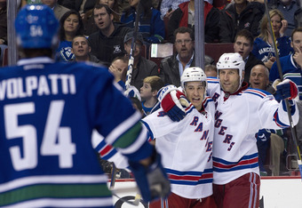 Mike Rupp (right) celebrates huge goal in Vancouver win